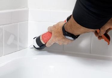 inspect caulking in bathrooms