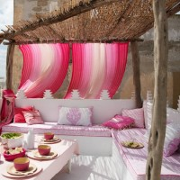 sun-room-terrace-garden-seating-open-middle-east-mediterranean-influence-open-seating-white-decorative-pink-cushions-flowy-design inspiration for home